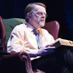 Brian O'Donovan, host of the radio show ''A Celtic Sojourn,'' sits onstage in an armchair, playing a listener to the performances in ''A Christmas Celtic Sojourn.""