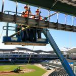 Workers drilled yesterday atop the Green Monster at JetBlue Park, the $78 million Red Sox training facility nearing completion in Fort Myers, Fla.