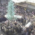 Anti-government protesters carried coffins of protesters killed in earlier clashes in the Damascus suburb of Zabadani.