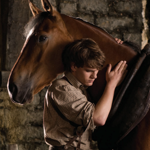 In this film image released by Disney, Jeremy Irvine is shown in a scene from
