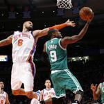 The Celtics' Rajon Rondo drove on the Knicks' Tyson Chandler in Madison Square Garden yesterday as the shortened NBA season began. Rondo scored 31 points, but the Celtics fell behind to stay in the final minute, 106-104.