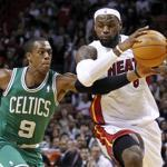 Miami's LeBron James (26 points, 2 in the fourth) was a driving force in the first half as he powered by Rajon Rondo (9) and Kevin Garnett.