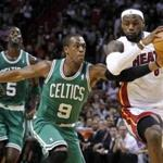 Celtics point guard Rajon Rondo defended against LeBron James in the first half of tonight's game in Miami.