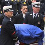 Peabody, Mass. -12/30/11 - Funeral services were held for Peabody firefighter James M. Rice at St. John The Baptist Church, as hundreds of firefighters from all over came to pay respect. In Peabody Aquare, Alex White, 8 and his friend Paige Biscaia, 6 both from Salem were allowed to stand in front of firefighters as they saluted along with them. Globe staff photo by John Tlumacki (metro)