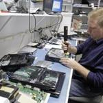 Technician Shawn Cable repaired a video game console at a computer store in Winter Park, Fla.