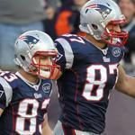 Rob Gronkowski, center, and Wes Welker, left, both were named to the first team All-Pro squad.
