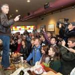 Jon Huntsman stood on a counter today at the Bean Towne Coffee House in Hampstead, N.H. Polls show Huntsman advancing ahead of Tuesday's primary.