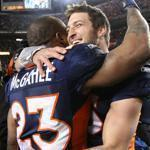 Quarterback Tim Tebow and running back Willis McGahee share a victory hug after the Broncos shocked the Steelers in the AFC wild-card game.