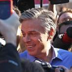 MANCHESTER,,NH 01 / 10 / 2012:Jon Huntsman on the right greets well wishers at the Webster School . ( David L Ryan / Globe Staff Photo ) SECTION: NATIONAL TOPIC : 11Primary REPORTER