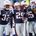 FOXBORO, MA - JANUARY 01: Sterling Moore #29 of the New England Patriots is congratulated by teammates Patrick Chung #25 and Devin McCourty #32 after Moore intercepted a pass against the Buffalo Bills on January 1, 2012 at Gillette Stadium in Foxboro, Massachusetts. (Photo by Elsa/Getty Images)