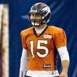 Tim Tebow stretched during practice yesterday.