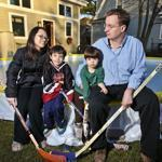 Jon Frankel of Brookline (center) checked the condition of his backyard skating rink as daughters Mia, 8, and Wendy, 10, and son Adam, 14, tried to slide on the thin ice last week.