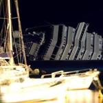 GIGLIO PORTO, ITALY - JANUARY 20: The cruise ship Costa Concordia lies stricken off the shore of the island of Giglio on January 19, 2012 in Giglio Porto, Italy. More than four thousand people were on board when the ship ran aground off the Tuscan coast on January 13. At least 11 people have been confirmed dead while another 20 remain missing. (Photo by Tullio M. Puglia/Getty Images)
