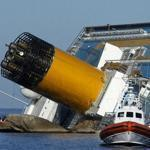 People watched a helicopter operating near the stricken cruise liner Costa Concordia off the Isola del Giglio today. Divers searching the wreck found a 12th body.