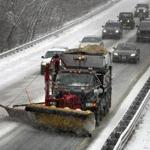 A plow cleared snow from Route 128 in Manchester-by-the-Sea today.