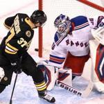 Patrice Bergeron tried to redirect  a shot into net the against the Rangers on the first period.