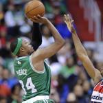 Roger Mason (right) and the rest of the Wizards were no match for Paul Pierce, who had a season-high 34 points and 10 assists.