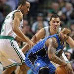 With starting guards Ray Allen and Rajon Rondo both out of the lineup with injuries, the starting Boston backcourt consisted of Avery Bradley (left) and Sasha Pavlovic (right), who are pictured doubling up on Magic guard Jameer Nelson in the first quarter.