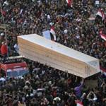 Egyptians carried an obelisk with the names of people who died during the 18-day uprising a year ago.