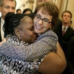 WASHINGTON, DC - JANUARY 25: Former U.S. Rep. Gabrielle Giffords gets a hug from House Cloak Room attendant Ella Terry after she resigned from the House of Representatives on January 25, 2012 in Washington, DC. Giffords resigned from Congress to focus on her recovery from a gunshot wound to the head she received last year from a lone gunman in Arizona. (Photo by Mark Wilson/Getty Images)