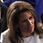 Former Republican presidential candidate Rep. Michele Bachmann, R-Minn., center arrives on Capitol Hill in Washington, Tuesday, Jan. 24, 2012, for President Barack Obama's State of the Union address. (AP Photo/Pablo Martinez Monsivais)