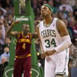 Paul Pierce walks away dejected while Anderson Varejao celebrates the Cavaliers' come-from-behind win over the Celtics.