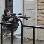 A Syrian rebel took his position as battled Syrian government forces today.