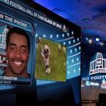 An image of Curtis Martin was shown as he spoke on the phone after he was inducted into the Pro Football Hall of Fame in Indianapolis, Ind.