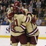 Boston College forward Steve Whitney was surrounded by teammates after his goal, as Northeastern defenseman Anthony Bitetto fell to the ice.