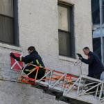 Firefighters posted a sign on the building on Harrison Ave. yesterday indicating that it is vacant and should not be entered in case of fire.