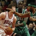 Chicago Bulls' Omer Asik was hit by Boston Celtics' Chris Wilcox as Kevin Garnett looked on during the first half of last night's game.