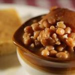 Baked beans served with cornbread.