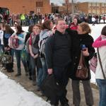 Students filed out of the high school in Chardon, Ohio, yesterday and went to a nearby elementary school to meet up with their parents after a teenager opened fire in the high school cafeteria.