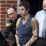 Sheriff's deputies led T.J. Lane, 17, to court in Chardon, Ohio, yesterday. The teen is accused in a shooting rampage Monday in a high school cafeteria.