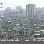 Damaged buildings covered in snow were seen in Baba Amr district of Homs in this image taken from video footage broadcast on Syria TV today. A Red Cross aid convoy prepared to enter the shattered district today.