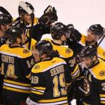 David Krejci (far right) has the attention of his teammates after completing his second career hat trick to beat the Devils at TD Garden.