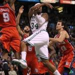 A second-half 3-pointer by Kevin Garnett (right) led to some chest-thumping and put a smile Paul Pierce's face.