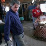Bernard Martin (foreground) and Doug Howlett tended to crab pots in their Petty Harbour fish shack.