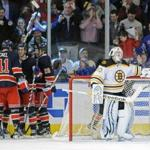 The Rangers celebrated a goal by Derek Stepan in the third period while Bruins goaltender Tim Thomas waited for play to resume. The Rangers defeated the Bruins 4-3.