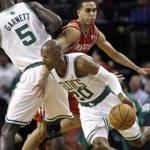 Ray Allen drove around Houston guard Kevin Martin, who ran into a pick by Kevin Garnett, in the first half.