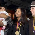 Tanisha Andrade, center, was honored by the 911 for Kids organization Thursday at the Yard House Restaurant in Boston.