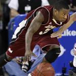 Chaz Williams and UMass survived to play again in the Atlantic 10 tournament.
