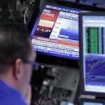 The rate decision of the Federal Reserve was shown on a television screen on the trading floor of the New York Stock Exchange Tuesday.
