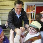 Mitt Romney spent his 65th birthday Monday campaigning at the Whistle Stop Cafe in Mobile, Ala.