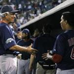 Bed Sox manager Bobby Valentine congratulated starter Felix Doubront after he pitched four scoreless innings in a spring training game against the Yankees tonight. The Red Sox won 1-0.
