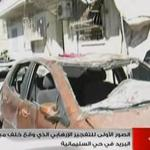 An image taken off official Syrian television on Sunday shows damaged vehicles following a car bomb in Syria's second largest city of Aleppo, a day after two lethal blasts in Damascus.