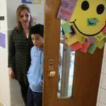 Nahid Yazdi and Josue Payano, 9, one of a half-dozen students that Yazdi counsels at the John F. Kennedy school in Boston.