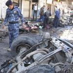 Iraqi security forces inspected the site of a bomb attack in Hilla, south of Baghdad, on Tuesday.
