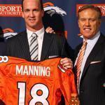 Quarterback Peyton Manning (center) poses with Broncos president and CEO Pat Bowlen (left) and executive vice president of football operations John Elway during a news conference in Englewood, Colorado.