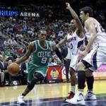 Celtics guard Rajon Rondo drove around Hawks guard Jeff Teague (0) and center Zaza Pachulia in the first half of Boston's win in Atlanta.